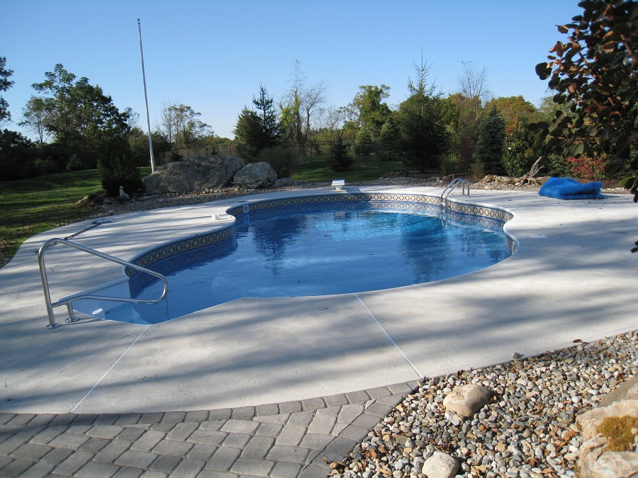 Concrete around in ground swimming pool