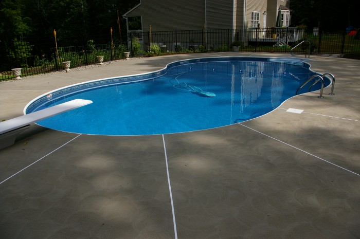 custom patios made from concrete for swimming pool surrounds