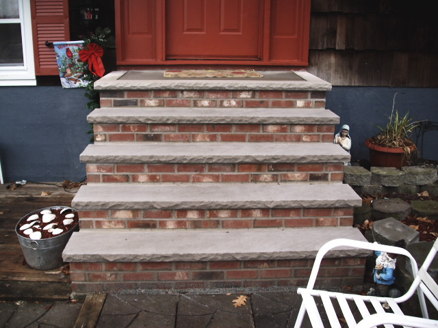 brick & cement stair way to home entrance