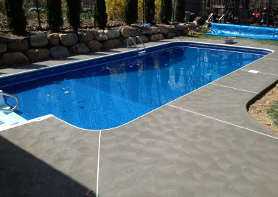 swimming pool patios made from hand-troweled concrete