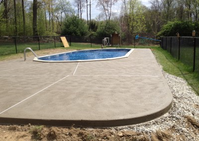 Concrete patio around sunken above ground pool