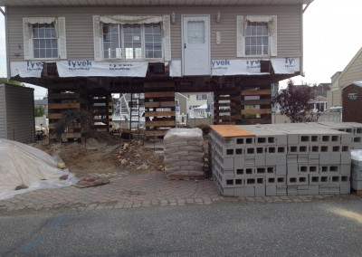 replacing block foundation for flood mitigation