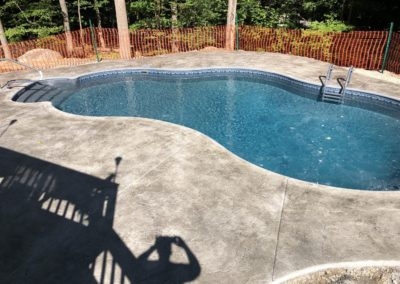 Gray Stamped concrete pool deck