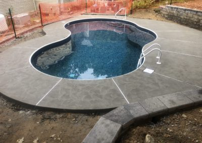 swirled-concrete-pool-patio